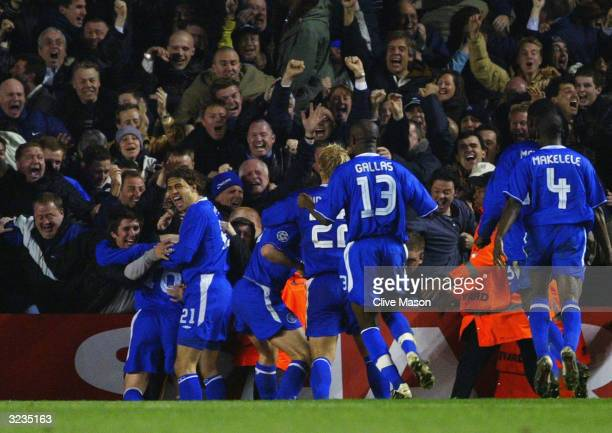 Wayne Bridge of Chelsea celebrates scoring their winning goal with the fans and his team mates during the UEFA Champions League Quarter Final Second...