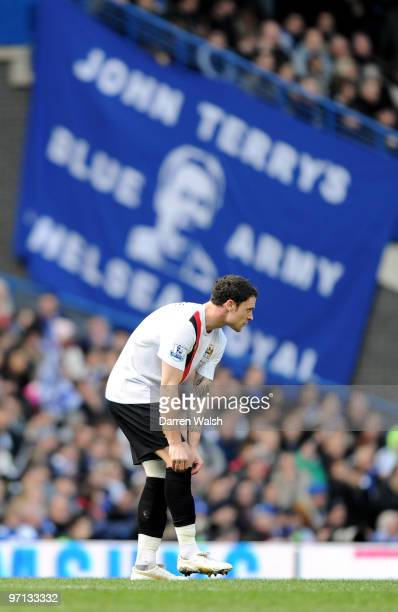 Wayne Bridge of Manchester City pulls up his socks in front of a John Terrysign during the Barclays Premier League match between Chelsea and...