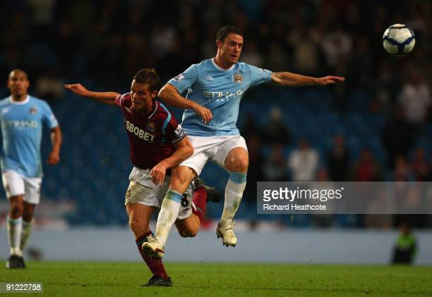 Wayne Bridge of Manchester City tangles with Scott Parker of West Ham United during the Barclays Premier League match between Manchester City and...