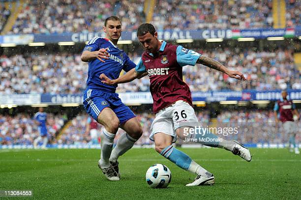 Wayne Bridge of West Ham clears the ball as Branislav Ivanovic of Chelsea cloese in during the Barclays Premier League match between Chelsea and West...