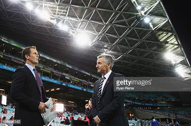 Wayne Carey and Bruce McAvaney look on before the 1st Preliminary Final AFL match between the Sydney Swans and the North Melbourne Kangaroos at ANZ...