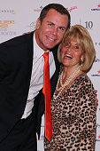 Wayne Carey and Lilian Frank pose at the 10th anniversary celebration of The Million Dollar Lunch at the Park Hyatt on October 17 2014 in Melbourne...