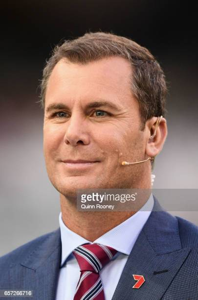 Wayne Carey commentates from the sidelines during the round one AFL match between the Collingwood Magpies and the Western Bulldogs at Melbourne...