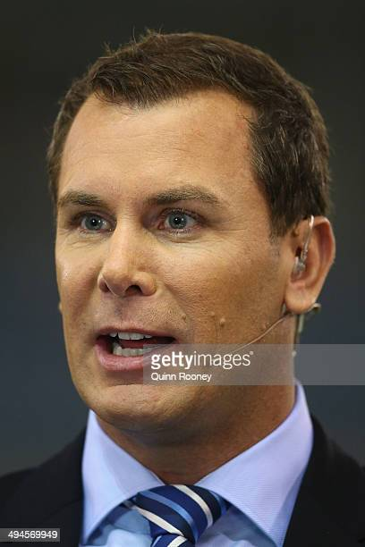 Wayne Carey commentates on the sidelines during the round 11 AFL match between the St Kilda Saints and the Collingwood Magpies at Etihad Stadium on...