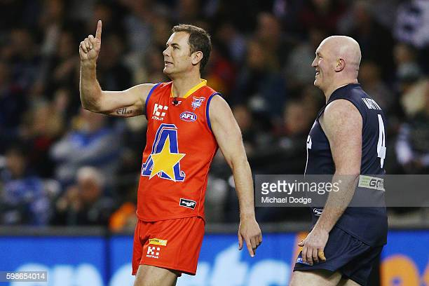 Wayne Carey of the All Stars gestures next to Mick Martyn of Victoria during the EJ Whitten Legends match at Etihad Stadium on September 2 2016 in...