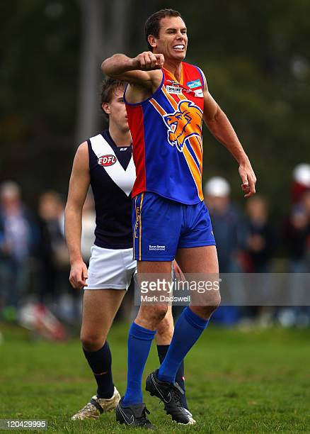 Wayne Carey playing for the Maribyrnong Lions hobbles to the boundary after suffering an injury during the Essendon Distrct Football League AFL match...