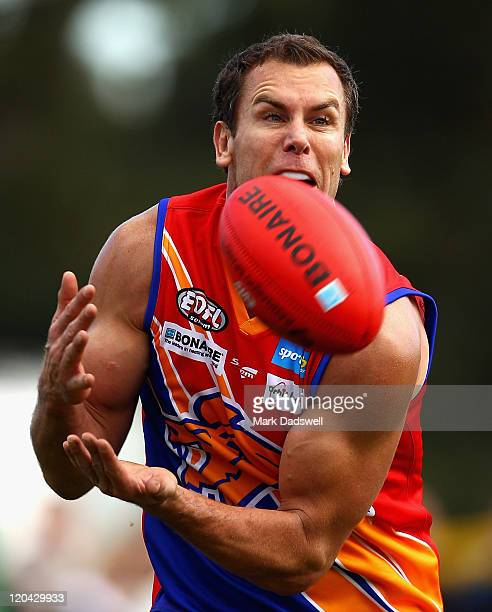 Wayne Carey playing for the Maribyrnong Lions marks on his chest after a strong lead during the Essendon Distrct Football League AFL match against...