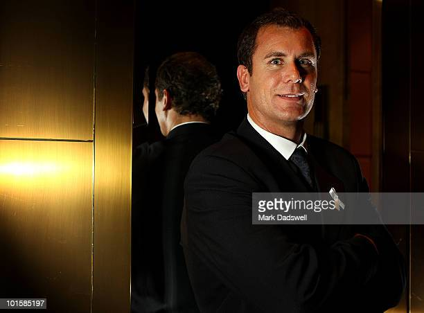 Wayne Carey poses for photos after becoming an inductee of the AFL Hall of Fame at the 2010 Australian Football Hall of Fame induction dinner at...