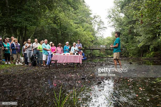 Wayne Castonguay speaks to members of the Ipswich River Watershed Association as they participate in a breakfast in the middle of Ipswich River in an...