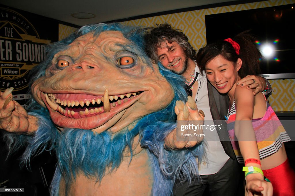 Wayne Coyne of the Flaming Lips and Gorburger backstage at The Warner Sound captured by Nikon during the 2013 SXSW Music, Film + Interactive Festival at The Belmont on March 14, 2013 in Austin, Texas.