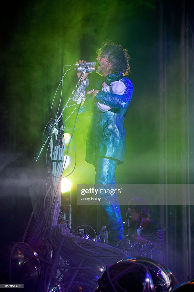 <a gi-track='captionPersonalityLinkClicked' href=/galleries/search?phrase=Wayne+Coyne&family=editorial&specificpeople=204435 ng-click='$event.stopPropagation()'>Wayne Coyne</a> of The Flaming Lips holds a baby doll as he performs onstage at Egyptian Room at Old National Centre on April 29, 2013 in Indianapolis, Indiana.