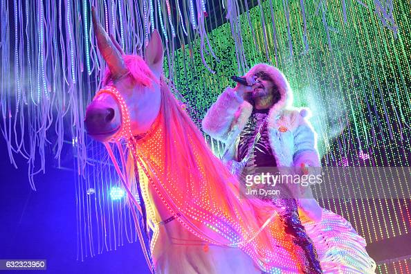 Wayne Coyne of The Flaming Lips performs live on stage astride a unicorn at Brixton Academy on January 21 2017 in London England