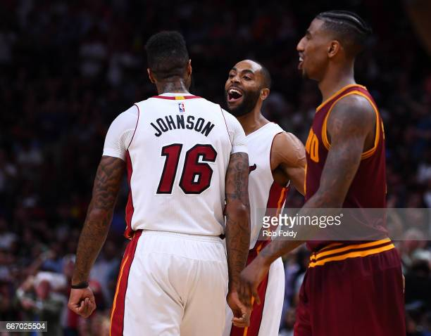 Wayne Ellington celebrates with James Johnson of the Miami Heat during the second half of the game against the Cleveland Cavaliers at the American...