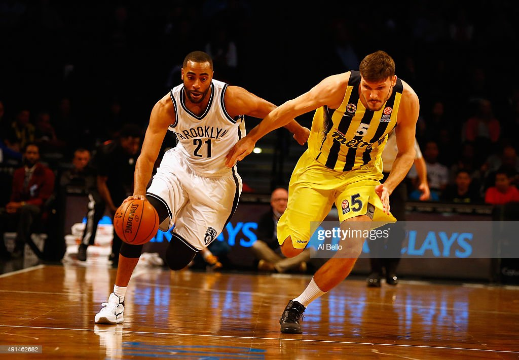Wayne Ellington of the Brooklyn Nets drives against Baris Hersek of Fenerbahce during their Pre Season game at the Barclays Center on October 5 2015...