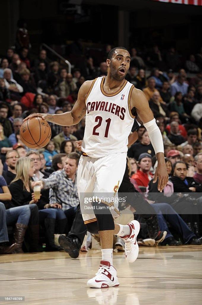 <a gi-track='captionPersonalityLinkClicked' href=/galleries/search?phrase=Wayne+Ellington&family=editorial&specificpeople=2351537 ng-click='$event.stopPropagation()'>Wayne Ellington</a> #21 of the Cleveland Cavaliers brings the ball up court against the Utah Jazz at The Quicken Loans Arena on March 6, 2013 in Cleveland, Ohio.