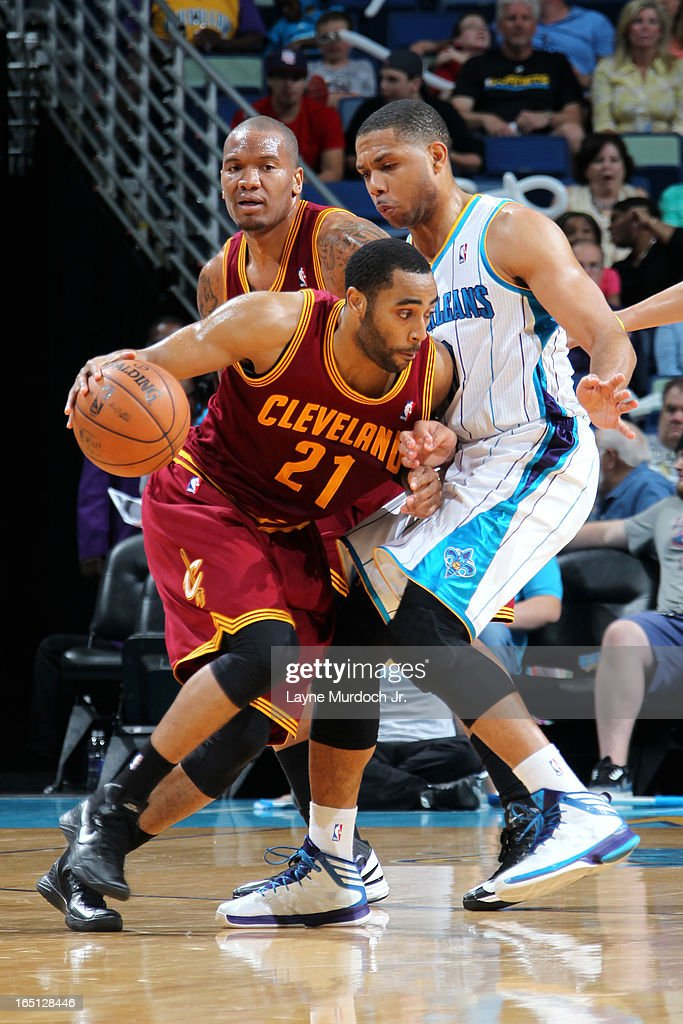 <a gi-track='captionPersonalityLinkClicked' href=/galleries/search?phrase=Wayne+Ellington&family=editorial&specificpeople=2351537 ng-click='$event.stopPropagation()'>Wayne Ellington</a> #21 of the Cleveland Cavaliers drives against <a gi-track='captionPersonalityLinkClicked' href=/galleries/search?phrase=Eric+Gordon+-+Basketball+Player&family=editorial&specificpeople=4212733 ng-click='$event.stopPropagation()'>Eric Gordon</a> #10 of the New Orleans Hornets on March 31, 2013 at the New Orleans Arena in New Orleans, Louisiana.