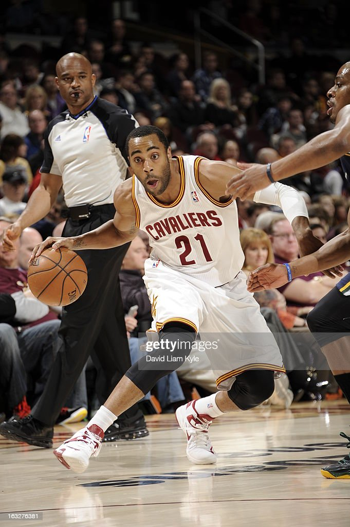 Wayne Ellington #21 of the Cleveland Cavaliers drives the ball under pressure during the game between the Cleveland Cavaliers and the Utah Jazz at The Quicken Loans Arena on March 6, 2013 in Cleveland, Ohio.