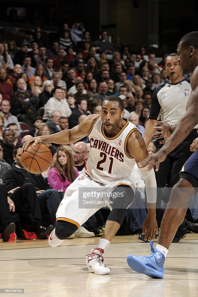 <a gi-track='captionPersonalityLinkClicked' href=/galleries/search?phrase=Wayne+Ellington&family=editorial&specificpeople=2351537 ng-click='$event.stopPropagation()'>Wayne Ellington</a> #21 of the Cleveland Cavaliers drives to the basket against the Memphis Grizzlies at The Quicken Loans Arena on March 8, 2013 in Cleveland, Ohio.