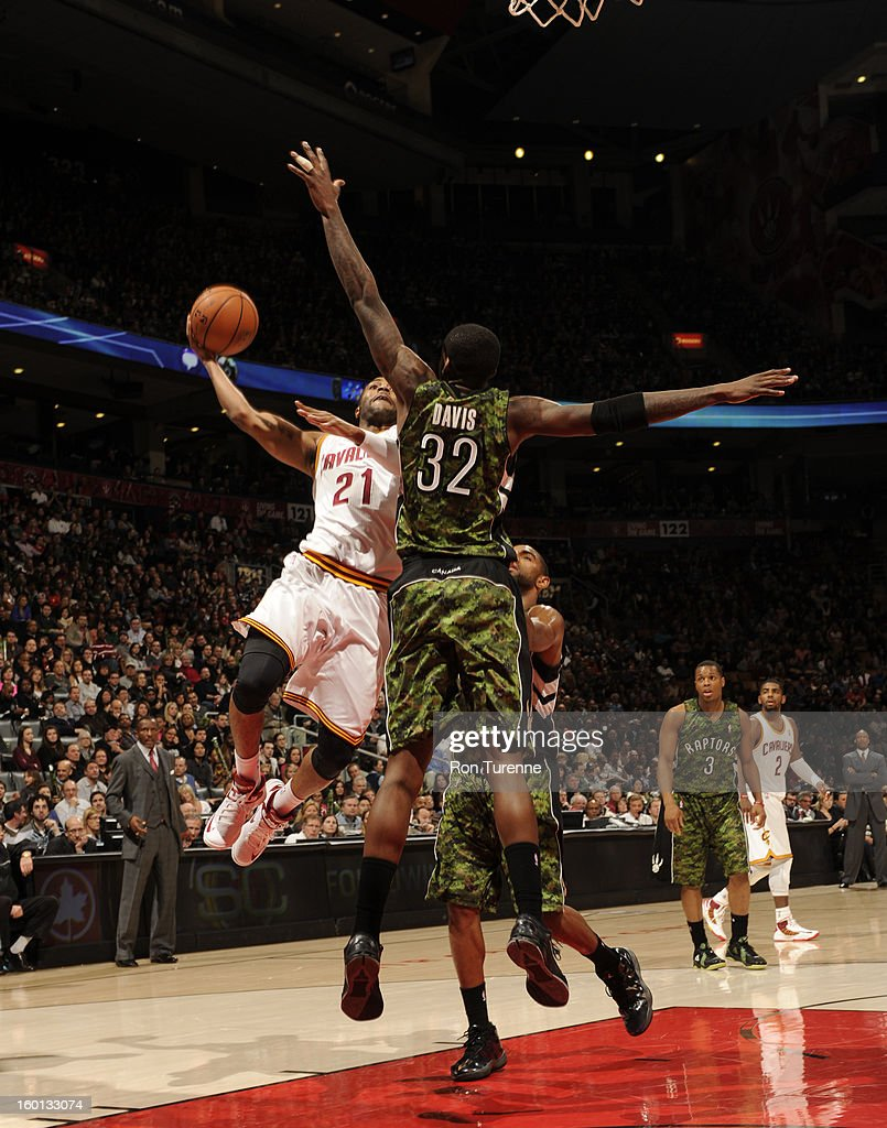Wayne Ellington #21 of the Cleveland Cavaliers goes to the basket against Ed Davis #32 of the Toronto Raptors during the game between the Toronto Raptors and the Cleveland Cavaliers on January 26, 2013 at the Air Canada Centre in Toronto, Ontario, Canada.