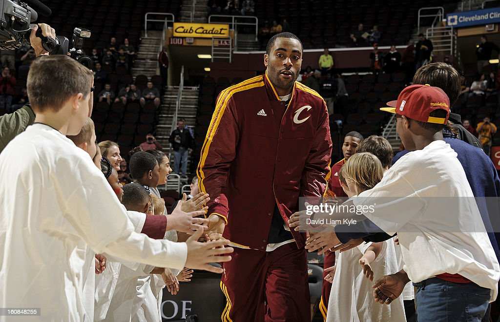Wayne Ellington #21 of the Cleveland Cavaliers greets some young fans as he takes the court prior to the game against the Charlotte Bobcats at The Quicken Loans Arena on February 6, 2013 in Cleveland, Ohio.