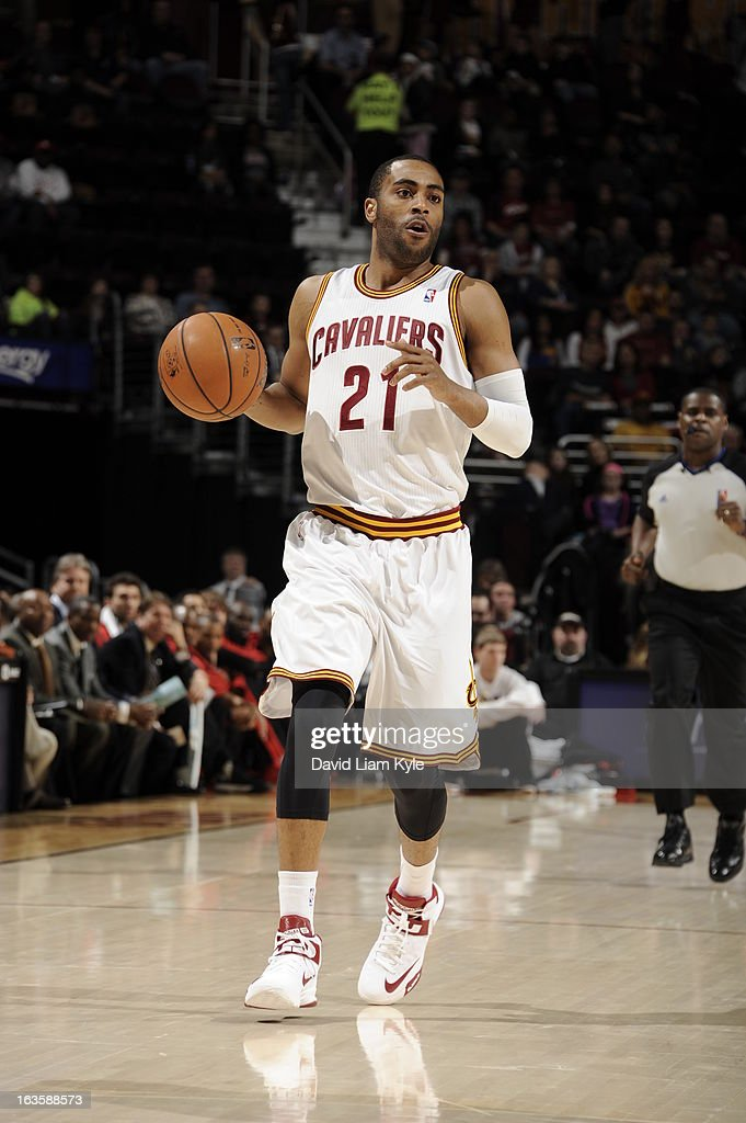 <a gi-track='captionPersonalityLinkClicked' href=/galleries/search?phrase=Wayne+Ellington&family=editorial&specificpeople=2351537 ng-click='$event.stopPropagation()'>Wayne Ellington</a> #21 of the Cleveland Cavaliers handles the ball Toronto Raptors at The Quicken Loans Arena on February 27, 2013 in Cleveland, Ohio.