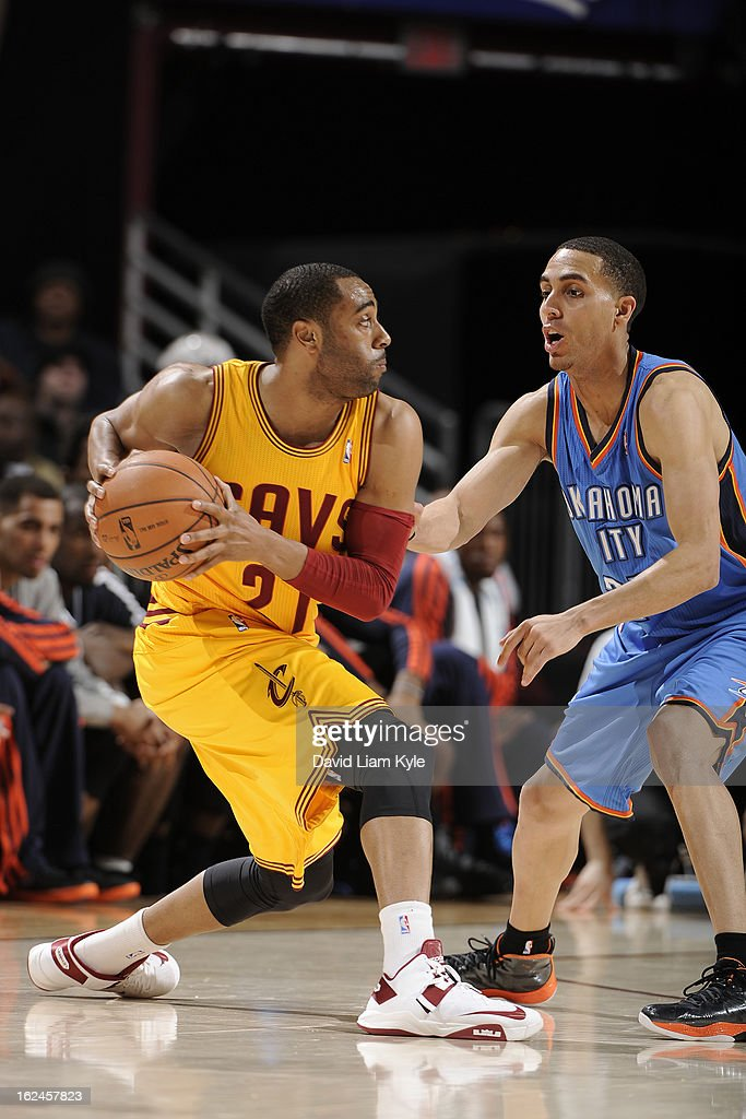 <a gi-track='captionPersonalityLinkClicked' href=/galleries/search?phrase=Wayne+Ellington&family=editorial&specificpeople=2351537 ng-click='$event.stopPropagation()'>Wayne Ellington</a> #21 of the Cleveland Cavaliers looks to pass the ball against the Oklahoma City Thunder at The Quicken Loans Arena on February 2, 2013in Cleveland, Ohio.