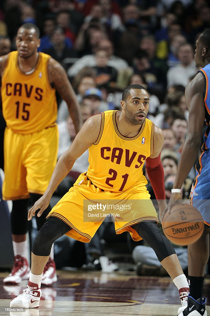 <a gi-track='captionPersonalityLinkClicked' href=/galleries/search?phrase=Wayne+Ellington&family=editorial&specificpeople=2351537 ng-click='$event.stopPropagation()'>Wayne Ellington</a> #21 of the Cleveland Cavaliers plays tight defense against the Oklahoma City Thunder at The Quicken Loans Arena on February 2, 2013in Cleveland, Ohio.