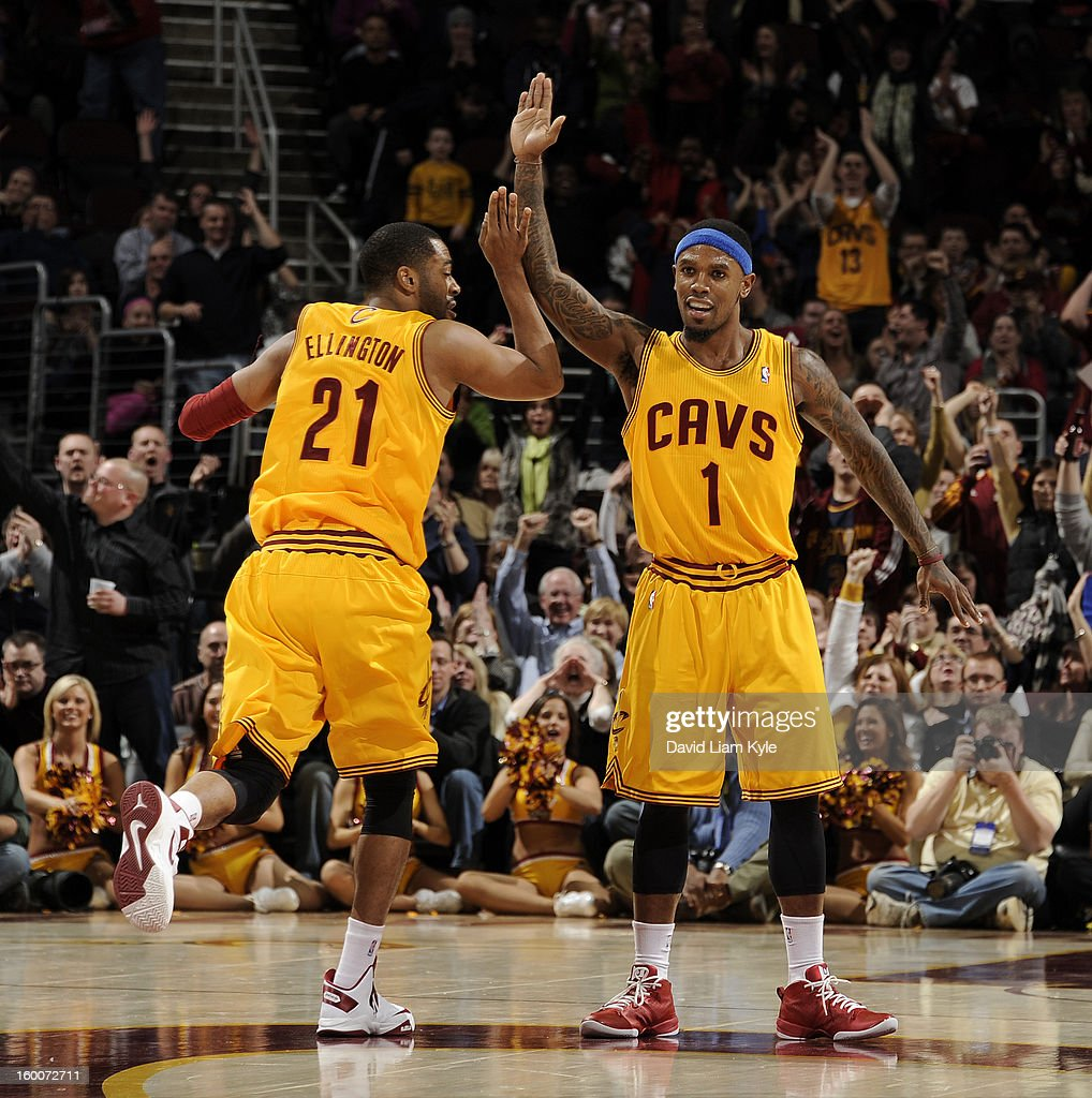 Wayne Ellington #21 of the Cleveland Cavaliers receives a high five from teammate Daniel Gibson #1 after sinking a three pointer to go ahead by one late in the game against the Milwaukee Bucks at The Quicken Loans Arena on January 25, 2013 in Cleveland, Ohio.