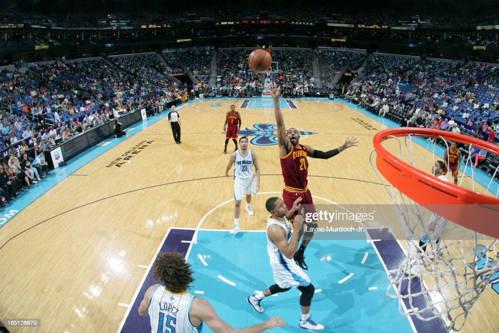 <a gi-track='captionPersonalityLinkClicked' href=/galleries/search?phrase=Wayne+Ellington&family=editorial&specificpeople=2351537 ng-click='$event.stopPropagation()'>Wayne Ellington</a> #21 of the Cleveland Cavaliers shoots against <a gi-track='captionPersonalityLinkClicked' href=/galleries/search?phrase=Eric+Gordon&family=editorial&specificpeople=4212733 ng-click='$event.stopPropagation()'>Eric Gordon</a> #10 of the New Orleans Hornetsp on March 31, 2013 at the New Orleans Arena in New Orleans, Louisiana.