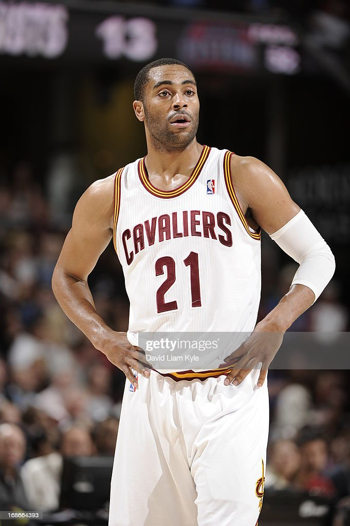 <a gi-track='captionPersonalityLinkClicked' href=/galleries/search?phrase=Wayne+Ellington&family=editorial&specificpeople=2351537 ng-click='$event.stopPropagation()'>Wayne Ellington</a> #21 of the Cleveland Cavaliers stands on the court during the game against the Detroit Pistons at The Quicken Loans Arena on April 10, 2013 in Cleveland, Ohio.