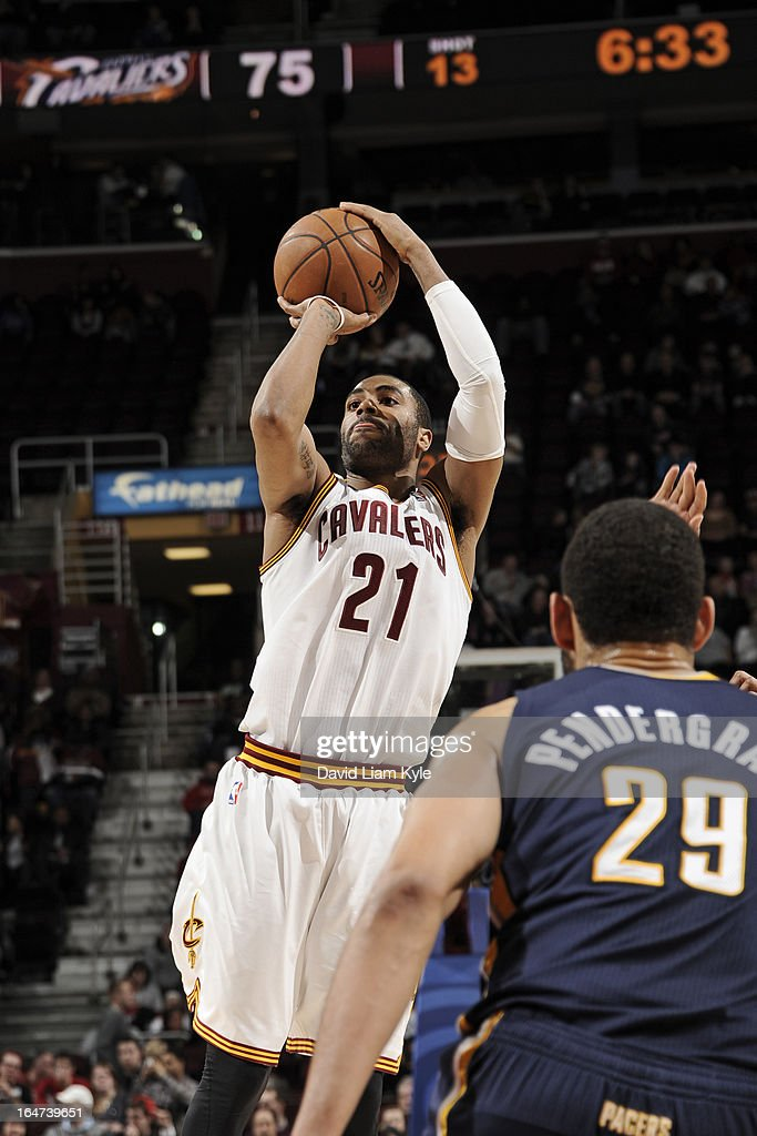 <a gi-track='captionPersonalityLinkClicked' href=/galleries/search?phrase=Wayne+Ellington&family=editorial&specificpeople=2351537 ng-click='$event.stopPropagation()'>Wayne Ellington</a> #21 of the Cleveland Cavaliers takes a shot against the Indiana Pacers at The Quicken Loans Arena on March 18, 2013 in Cleveland, Ohio.