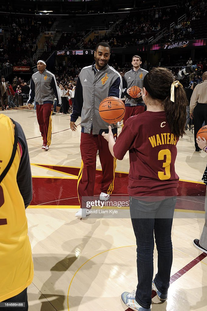 <a gi-track='captionPersonalityLinkClicked' href=/galleries/search?phrase=Wayne+Ellington&family=editorial&specificpeople=2351537 ng-click='$event.stopPropagation()'>Wayne Ellington</a> #21 of the Cleveland Cavaliers walks out on the court during the game against the Los Angeles Clippers at The Quicken Loans Arena on March 1, 2013 in Cleveland, Ohio.