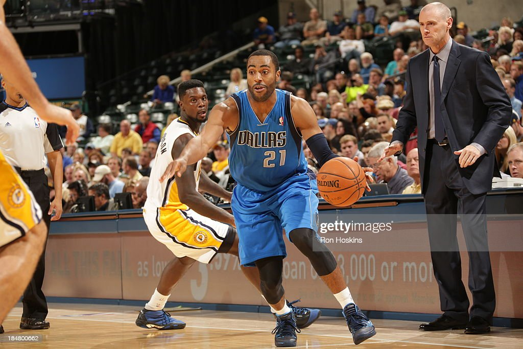 <a gi-track='captionPersonalityLinkClicked' href=/galleries/search?phrase=Wayne+Ellington&family=editorial&specificpeople=2351537 ng-click='$event.stopPropagation()'>Wayne Ellington</a> #21 of the Dallas Mavericks drives against the Indiana Pacers at Bankers Life Fieldhouse on October 16, 2013 in Indianapolis, Indiana.