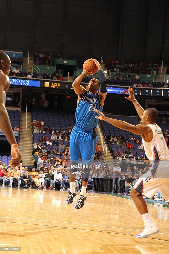 Wayne Ellington #21 of the Dallas Mavericks shoots the ball against the Charlotte Bobcats at the Greensboro Coliseum on October 19, 2013 in Greensboro, North Carolina.