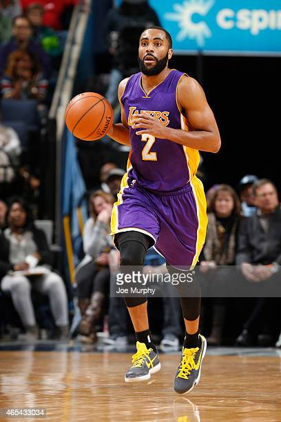 Wayne Ellington of the Los Angeles Lakers brings the ball up court against the Memphis Grizzlies on March 6 2015 at the FedExForum in Memphis...