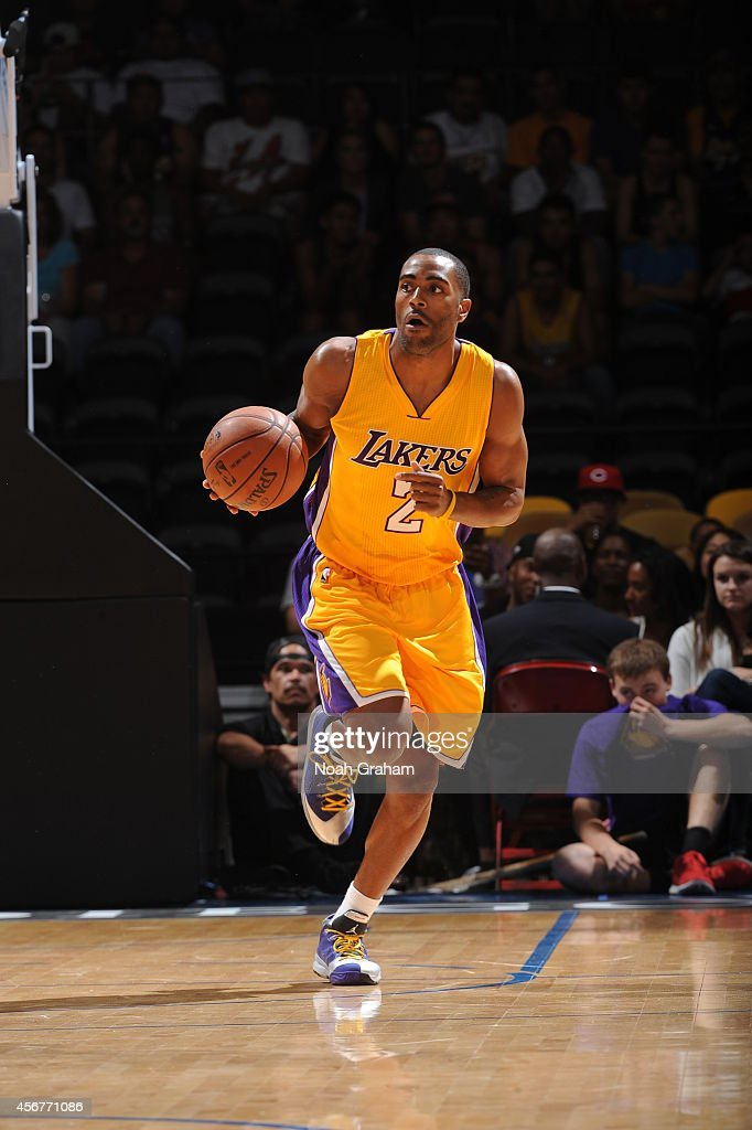 Wayne Ellington of the Los Angeles Lakers dribbles down court against the Denver Nuggets as the Los Angeles Lakers take on the Denver Nuggets at the...