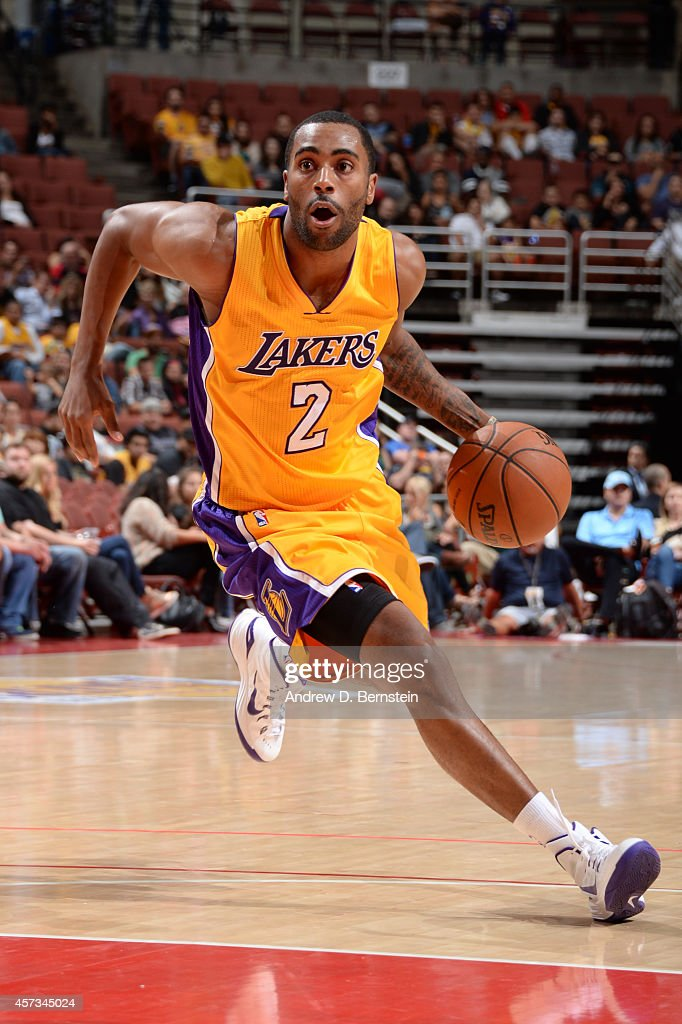 Wayne Ellington of the Los Angeles Lakers drives to the basket during a game against the Utah Jazz at Honda Center on October 16 2014 in Anaheim...