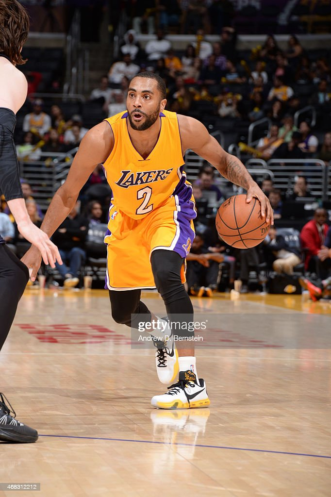 Wayne Ellington of the Los Angeles Lakers drives to the basket against the New Orleans Pelicans during the game at STAPLES Center on April 1 2015 in...