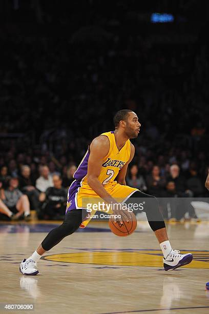 Wayne Ellington of the Los Angeles Lakers handles the ball against the Oklahoma City Thunder at STAPLES Center on December 19 2014 in Los Angeles...