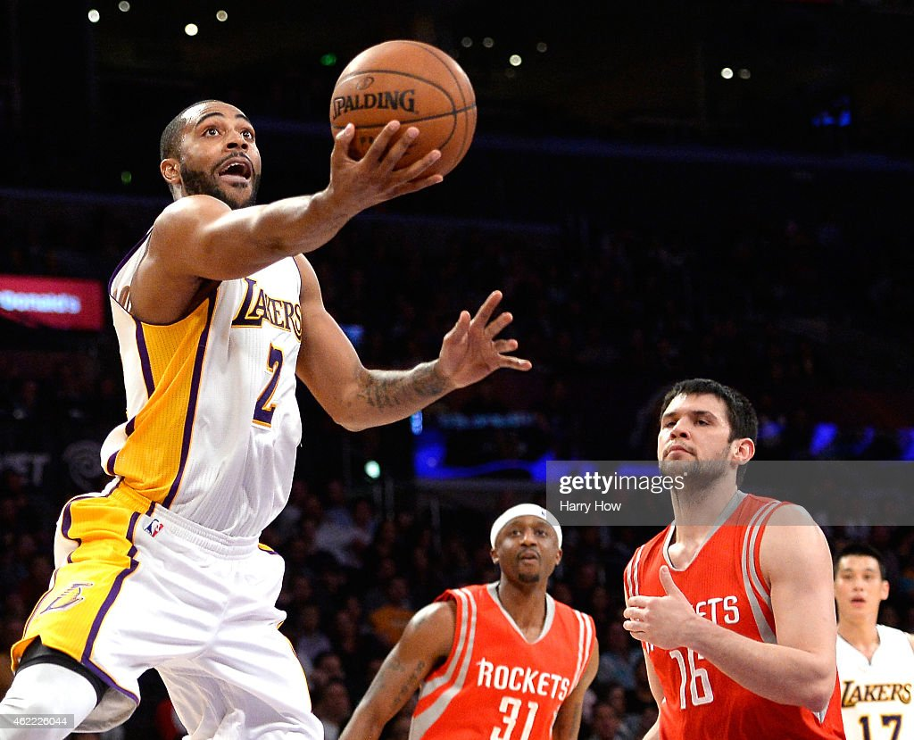 Wayne Ellington of the Los Angeles Lakers scores on a layup past Kostas Papanikolaou and Jason Terry of the Houston Rockets during a 9987 Rockets win...