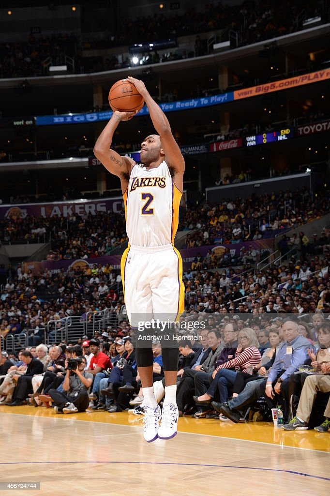 Wayne Ellington of the Los Angeles Lakers shoots against the Charlotte Hornets on November 9 2014 at Staples Center in Los Angeles California NOTE TO...
