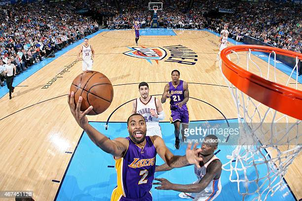 Wayne Ellington of the Los Angeles Lakers shoots the ball against the Oklahoma City Thunder on March 24 2015 at the Chesapeake Energy Arena in...