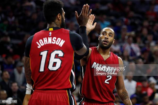 Wayne Ellington of the Miami Heat celebrates a first half play with James Johnson while playing the Detroit Pistons at the Palace of Auburn Hills on...