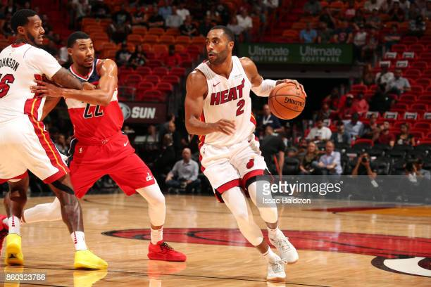 Wayne Ellington of the Miami Heat handles the ball during a preseason game against the Washington Wizards at the American Airlines Arena on October...