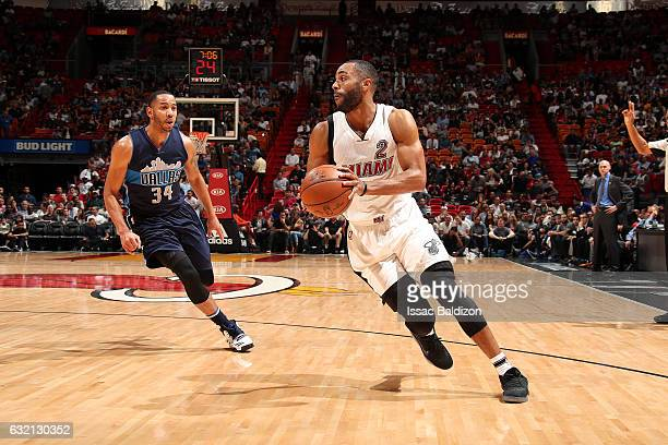 Wayne Ellington of the Miami Heat handles the ball during the game against the Dallas Mavericks on January 19 2017 at AmericanAirlines Arena in Miami...