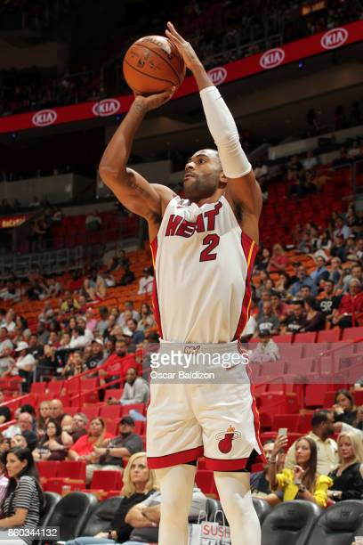 Wayne Ellington of the Miami Heat shoots the ball during a preseason game against the Washington Wizards at the American Airlines Arena on October 11...