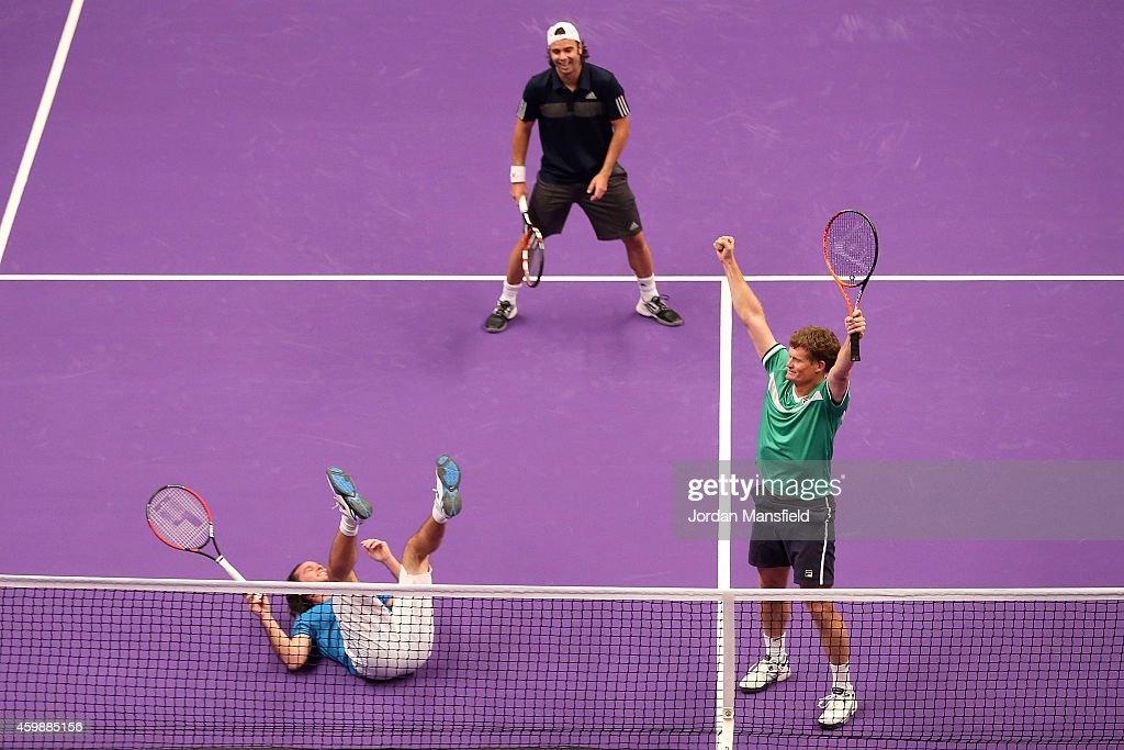 Wayne Ferreira of South Africa celebrates as Xavier Malisse of Belgium falls over the net during the Mens Doubles match between Wayne Ferreira and Fernando Gonzalez against Xavier Malisse and Jamie Murray on day one of the Statoil Masters Tennis at the Royal Albert Hall on December 3, 2014 in London, England.