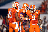 Wayne Gallman of the Clemson Tigers celebrates with Stanton Seckinger after scoring a touchdown in the fourth quarter against the Oklahoma Sooners...