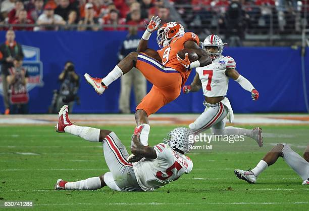 Wayne Gallman of the Clemson Tigers is upended by Raekwon McMillan of the Ohio State Buckeyes during the first half of the 2016 PlayStation Fiesta...