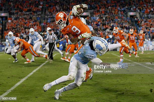 Wayne Gallman of the Clemson Tigers runs the ball against Dominquie Green of the North Carolina Tar Heels during the Atlantic Coast Conference...